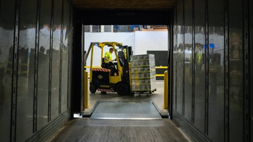 forklift man carrying box using fork liftr