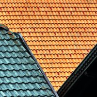 roofing company brown and green house roof