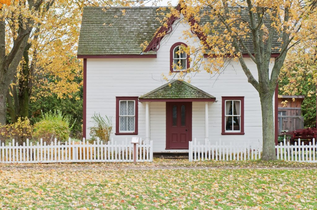 home white house under maple trees