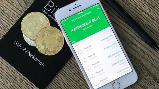bitcoin wallet silver iPhone 6 beside two coins