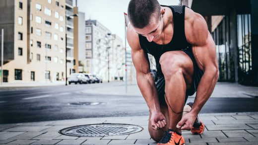 Best Dad Fitness man tying his shoes