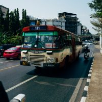 Trucking Authority red and white bus on road during daytime