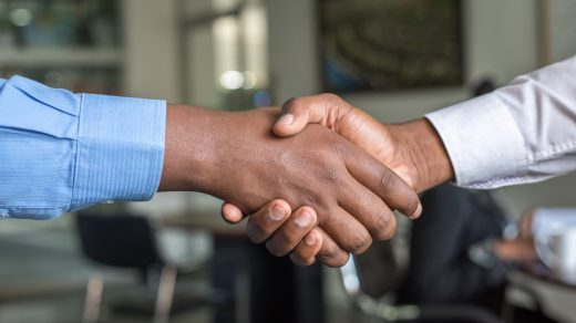 partnership two people shaking hands