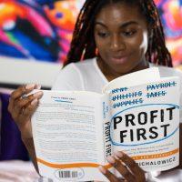 Financial Plan woman in white long sleeve shirt holding white printer paper