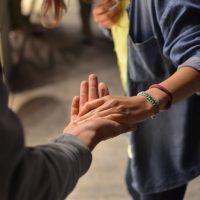 CARE act - man and woman holding hands on street