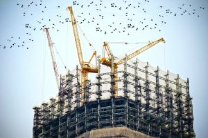 enterprise construction management software low angle photography of cranes on top of building