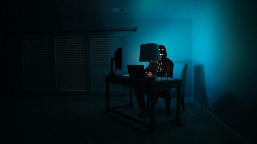 White Hat Hackers man siting facing laptop