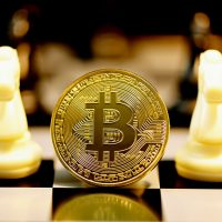 bitcoin games gold and silver round coin