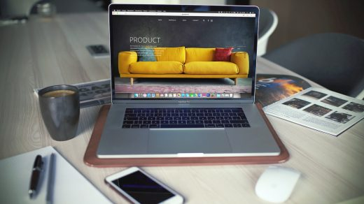 Boost Your Online Business turned on MacBook Pro beside gray mug