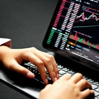 forex trading person using black laptop computer